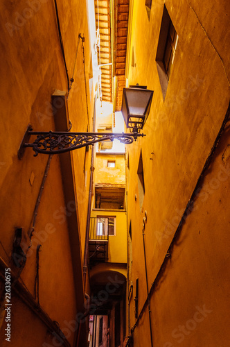 Narrow passage between the buildings in Italy