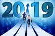 Leinwanddruck Bild - Businessman running into year of 2019