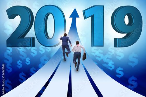 Leinwanddruck Bild Businessman running into year of 2019