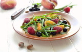 Summer salad with fruits and vegetables