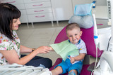Little boy and mother expect dentist in an armchair - 226373587