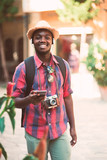 African traveller man feel happy and freedom with listen music from smartphone.