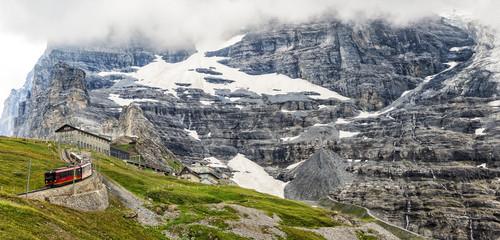 Swiss Scenic Mountain Train with Glacier Background