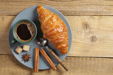 Coffee with croissant and spice