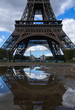 A reflection of the bottom half of the Eiffel Tower