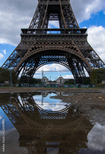 A reflection of the bottom half of the Eiffel Tower - 226389375
