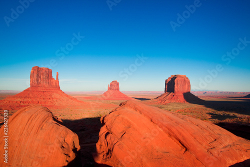 sunset in the desert with scenic rocks and monument