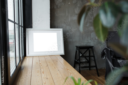 White isolated posters with frame mockup in interior © horimono
