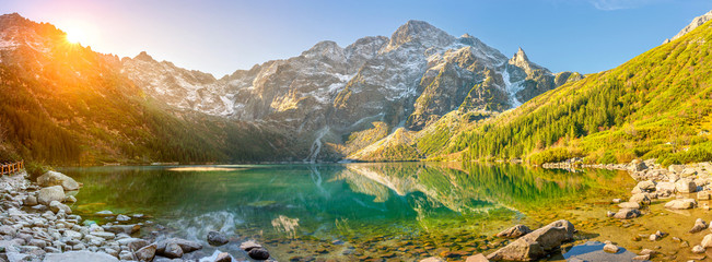Tatra National Park, a lake in the mountains at the dawn of the sun. Poland
