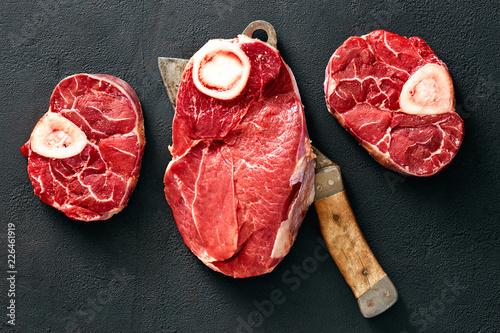 Bone beef meat butcher knife black background top view - 226461919