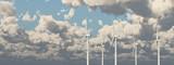 Wind turbines against a cloudy sky