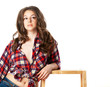 Beautiful sexy topless young woman wearing red plaid shirt. Isolated over white