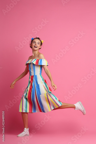 Fashion cool girl posing on pink background. Young hipster woman, studio shot © MaxFrost