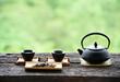 Leinwandbild Motiv set Chinese tea on the old wood table green nature background