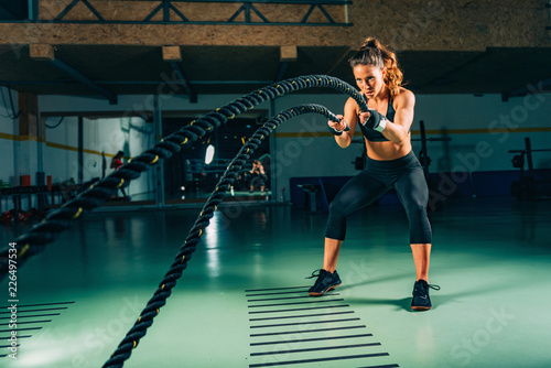 Cross training. Rope swing exercise - 226497534