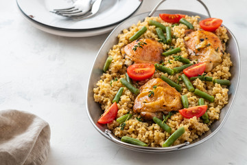 Grilled chicken thighs with bulgur, asparagus beans and tomatoes. Delicious lunch.