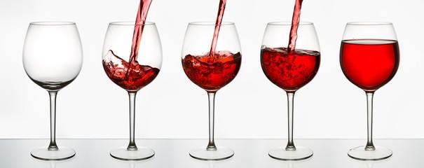 Beautiful splash of red wine in glasses © chagin