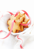 Gingerbread cookies with check ribbon in a bowl. Christmas time. White background. Close up. Copy space.  - 226525787