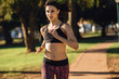 Fit woman on morning run at the park