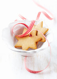 Gingerbread cookies with check ribbon in a bowl. Christmas time. White background. Close up. Copy space.  - 226529304