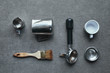 top view of professional tools for preparing coffee on grey