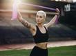 Leinwanddruck Bild - Fitness woman doing workout standing in a stadium