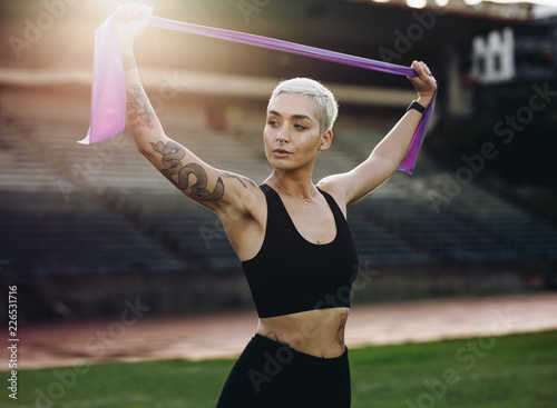 Fitness woman doing workout standing in a stadium