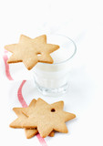 Gingerbread cookies and a Glass of Milk. Christmas time. White background. Close up. Copy space.   - 226552714