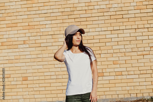 Young sexy swag girl. Outdoor lifestyle portrait of female in brown cap.  Summer photo