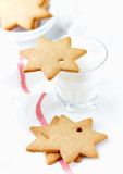 Gingerbread cookies and a Glass of Milk. Christmas time. White background. Close up. Copy space.   - 226557369