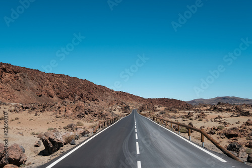 straight highway road through desert, mountain landscape