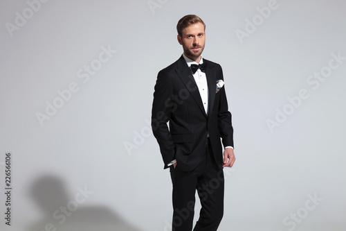 Leinwandbild Motiv young elegant man wearing tuxedo and bowtie