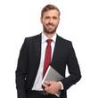 Leinwandbild Motiv portrait of handsome businessman holding tablet and laughing