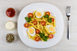 Pasta with boiled eggs, tomatoes, parsley, mayonnaise, ketchup, condiment - 226573937