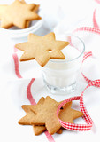 Gingerbread cookies and a Glass of Milk. Christmas time. White background. Close up. Copy space.   - 226575390