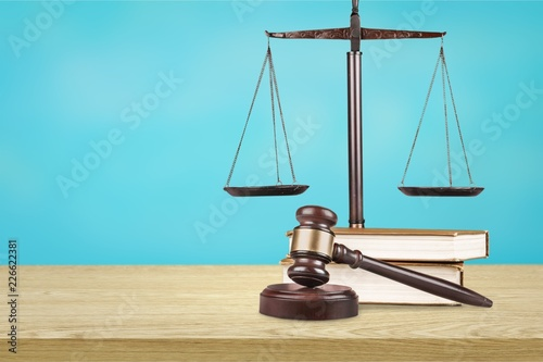 Law scales on table background. Symbol of