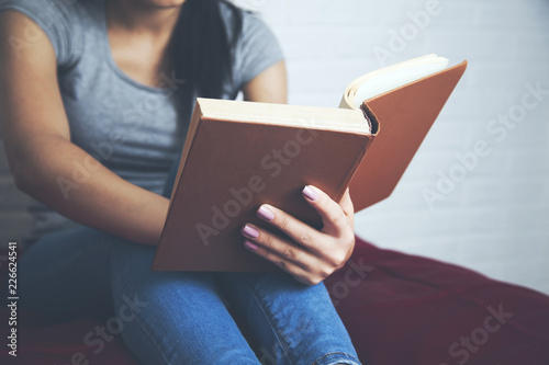 woman on the bed with hand book