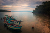 old fishing boat at sunrise.