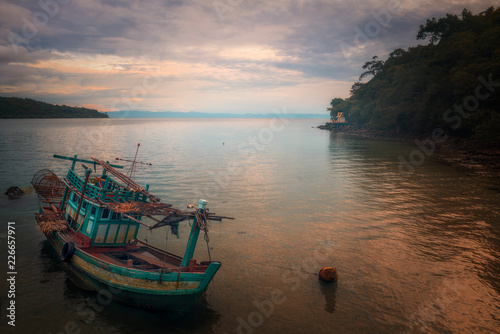 old fishing boat at sunrise.