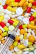 Syringe on Pills