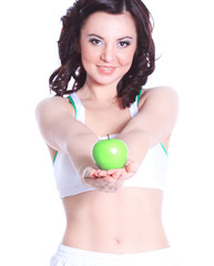 beautiful fitness woman with green Apple.photo with copy space