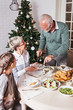 Family gathered over for Christmas holidays, celebrating, having lunch  - 226706933
