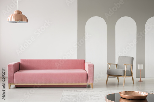 Real Photo Of A Creative Living Room Interior Decorated With Arches Pink Sofa And Retro