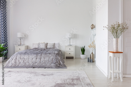Leinwanddruck Bild Luxury bedroom interior design with silver duvet and pillows on kind size bed, real photo with copy space