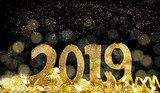 golden sparkly figures 2019 standing on glitters and ribbon on the abstract night - 226730195
