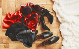 scattered clothes and lovers shoes. Night of love. Selective focus