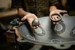 Hands designing handpan in a workshop