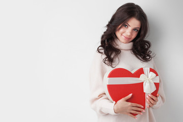 Girl with red heart-shaped box