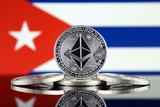 Physical version of Ethereum (ETH) and Cuba Flag. Conceptual image for investors in cryptocurrency, Blockchain Technology, Smart Contracts, Personal Tokens and Initial Coin Offering.