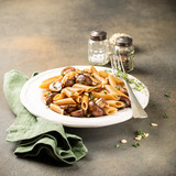 Homemade whole grain pasta penne with fried mushrooms and thyme on white plate. Delicious healthy italian vegetarian food background. Copy space. - 226769739